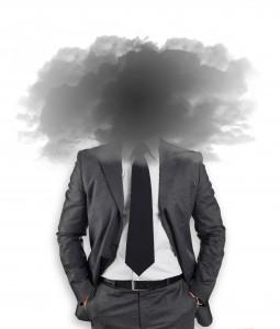 Businessman - head in the black clouds